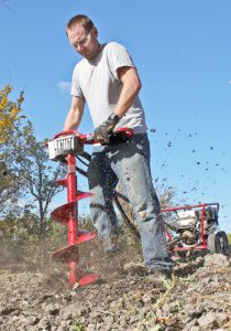 Our Drill helps us erect post and rail fencing straight and square in all soils.